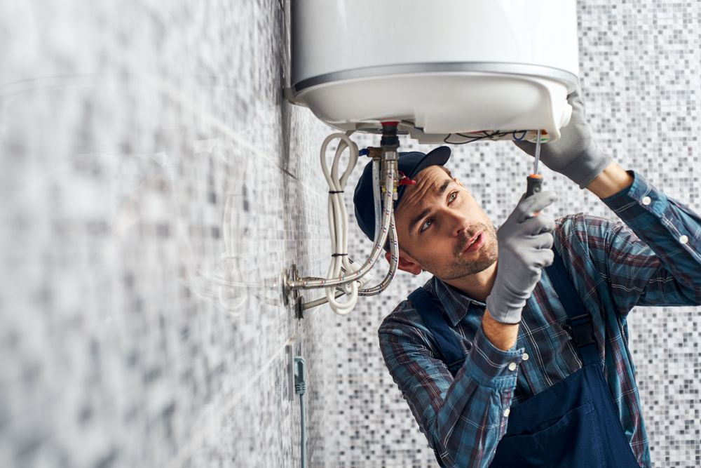 Image Of Plumber Doing Water Heater Repair For Hot Water Not Working